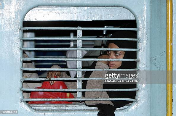 A passenger peeps out of the window aboard the Samjhauta Express at the Old Delhi Railway Station in Delhi 21 February 2007 The twiceweekly service...