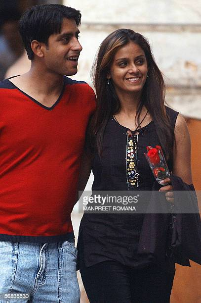 A young Indian couple hold each other in New Delhi 13 February 2006 on the eve of Valentine's Day Hindu nationalists declaring they were not against...