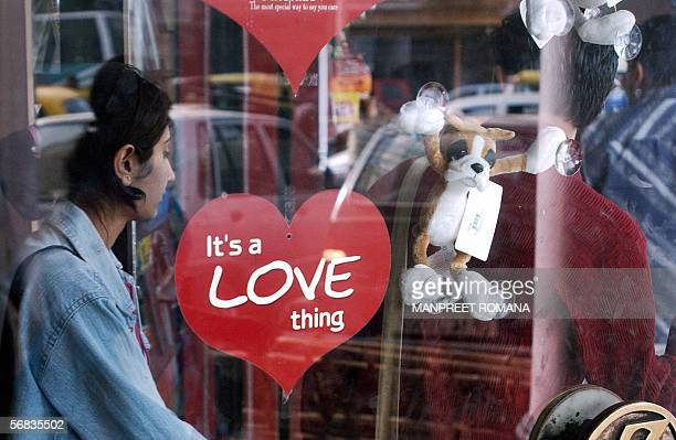 A young Indian couple walk out of a gift shop in New Delhi 13 February 2006 on the eve of Valentine's Day Hindu nationalists declaring they were not...