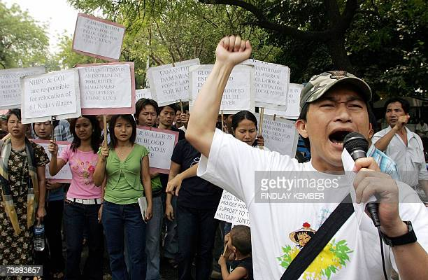 Activists representing the Ethnic minority Kuki people hold placards and chant slogans during a demonstration against the construction of the...