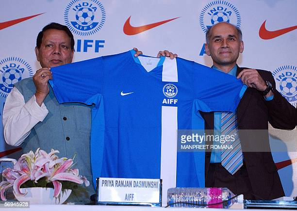 All India Football Federation President Priya Ranjan Dasmunshi and General Manager Nike India Sanjay Mehra hold the new jersey for the Indian...