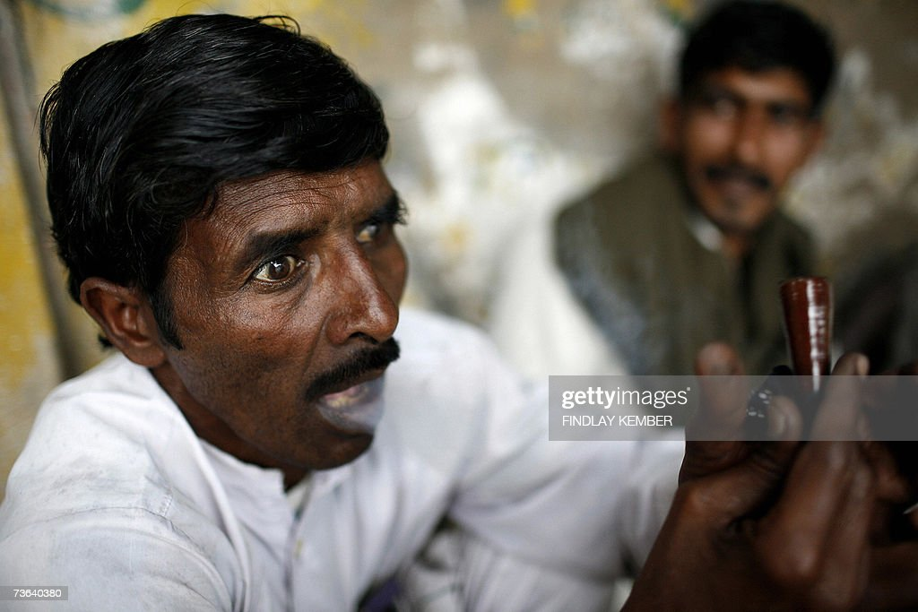An Indian man exclaims as he exhales smoke after smoking a chillum of hashish at a roadside tea stall in New Delhi, 20 March 2007. Cannabis, also known as marijuana or ganja in its herbal form and hashish in its resinous form, is a psychoactive product of the plant Cannabis Sativa. Used by many cultures across the centuries, from Ancient Scythians to modern sects, and with often touted medicinal benefits, many individuals also consider their use of cannabis to be spiritual regardless of organised religion. AFP PHOTO/Findlay KEMBER