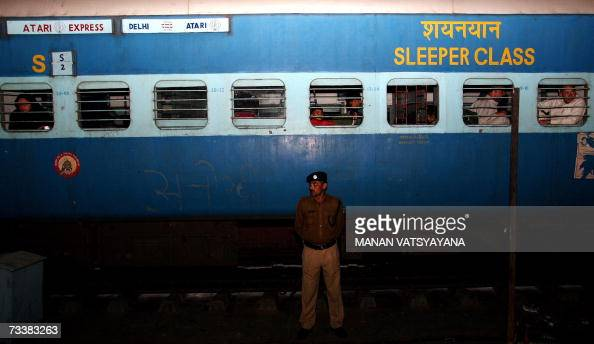 An Indian Paramilitary officer stands guard on the platform in front of the Samjhauta Express at the Old Delhi Railway Station in Delhi 21 February...