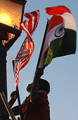 AN Indian worker puts up US and Indian flags on Rajpath in New Delhi 28 February 2006 on the eve of US President George W Bush's visit to India India...