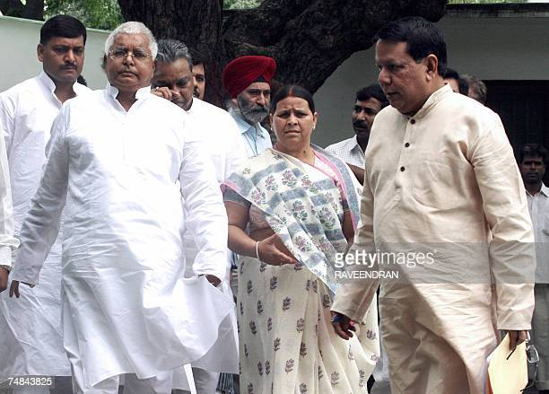 CORRECTION Indian Railway Minister and President of the Rashtriya Janata Dal party Lalu Prasad Yadav and his wife and former Bihar Chief Minister...