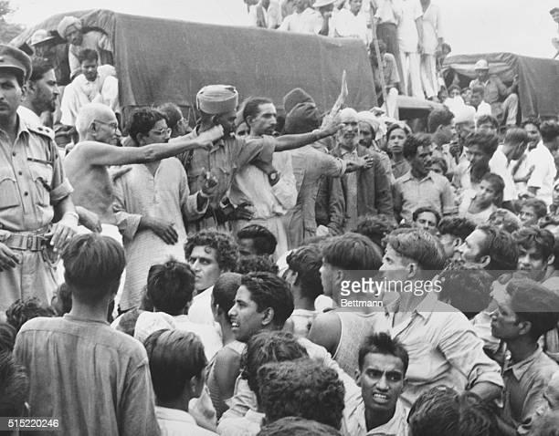 Gandhi Visits Muslim Refugees Mohandas K Gandhi Hindu Spiritual Leader waves to the Muslim crowd on his visit to the Purana Qila camp where 50000...