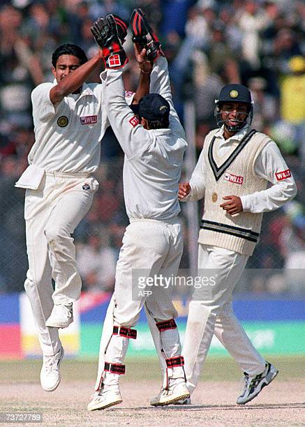 In this picture taken 05 February 1999 Indian cricketer Anil Kumble celebrates with wicketkeeper Nayan Mongia and fielder Sadagopan Ramesh after the...