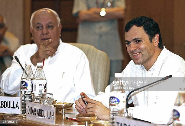 In this picture taken 24 April 2007 Former Jammu and Kashmir Chief Minister Farooq Abdullah along with his son and President of the National...