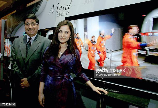 Indian actress Simone Singh poses with Deputy Managing Director Samsung India Ravinder Zutshi at the launch of a range of 'flat panel' televisions in...
