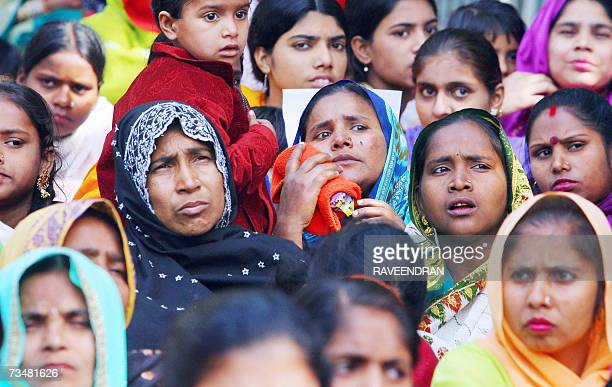 Indian Dalit Christian and Muslim women listen to leaders during a rally against the National Commission for Scheduled Castes and Scheduled Tribes...
