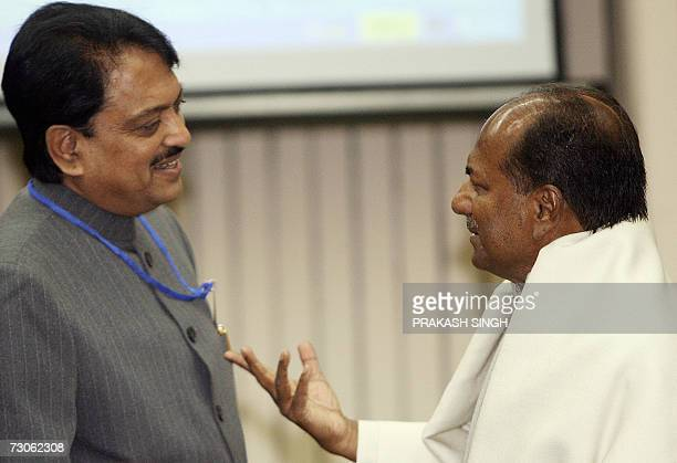 Indian Defence Minister A K Antony gestures as he talks with Maharastra state Chief Minister Vilas Rao Deshmukh during a meeting in New Delhi 22...