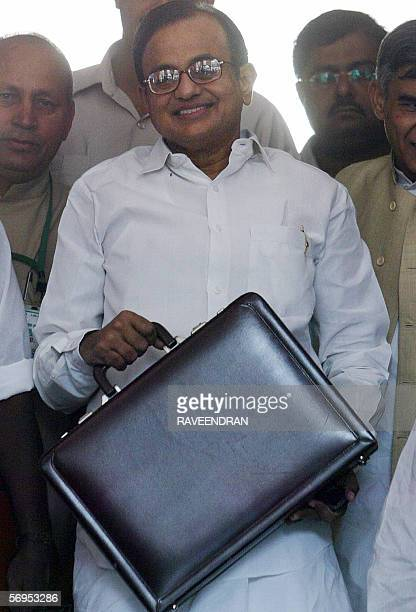 Indian Finance Minister P Chidambaram arrives at the National Parliament to present the government's federal budget for the fiscal year starting 01...