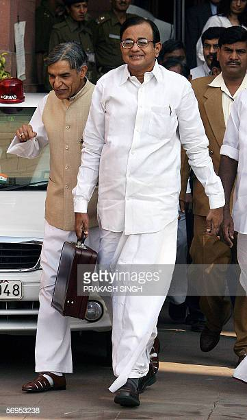 Indian Finance Minister P Chidambaram comes out of the finance ministry on his way to the National Parliament where he was to present the...