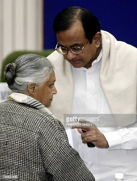 Indian Finance Minister P Chidambaram gestures as he talks with Delhi state Chief Minister Shiela Dikshit during a meeting in New Delhi 22 January...