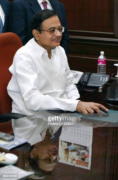 Indian Finance Minister P Chidambaram poses for photographers at his office on the eve of the presentation of the government's federal budget for the...
