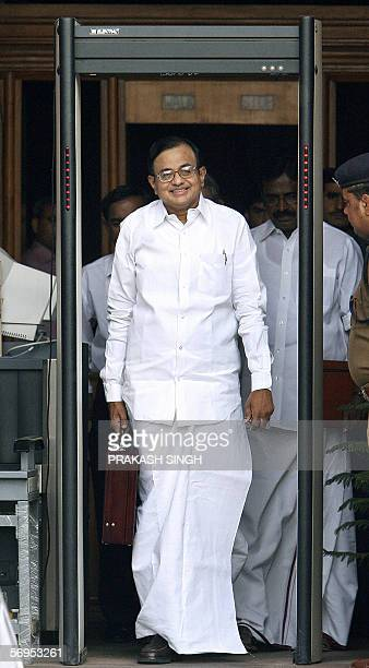 Indian Finance Minister P Chidambaram walks through a security gate out of the finance ministry on his way to the National Parliament where he was to...
