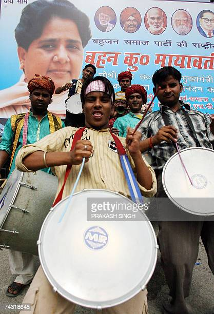 Indian folk musicians play outside the Bahujan Samaj Party office prior to a ceremony to congratulate the new Chief Minister of the Indian state of...