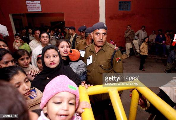 Indian Paramilitary officers stand guard on the platform of the Samjhauta Express at the Old Delhi Railway Station in Delhi 21 February 2007 The...