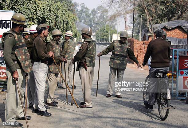 Indian policemen stop a cyclist entering the court compound in Ghaziabad 30 km east of New Delhi 08 February 2007 Indian businessman Moninder Singh...