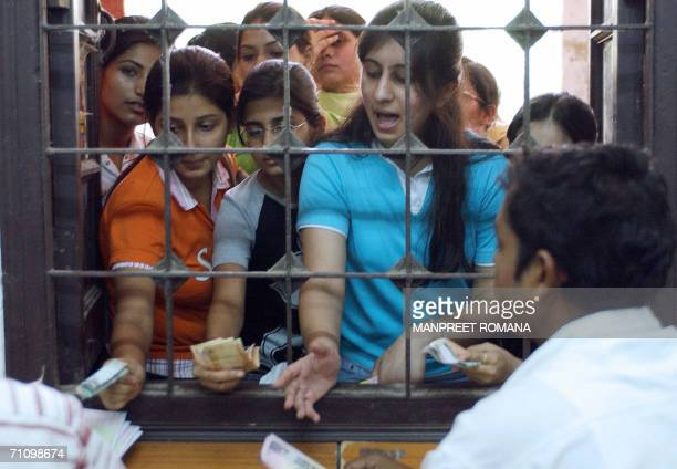 Indian students buy admission forms at the Delhi University in New Delhi 01 June 2006 Students have started 01 June to apply for admissions to...