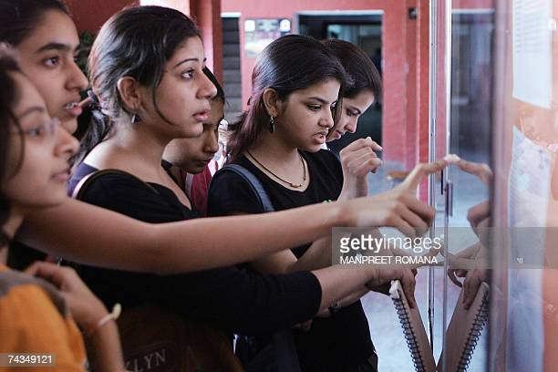 Indian students from St Thomas School check their Class Ten Central Board of Secondary Education results on a school notice board in New Delhi 29 May...