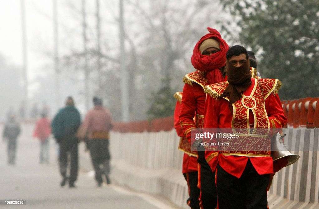 New Delhi, India - January 03 - Members of a Band party dares chilling cold as temperature remains low in New Delhi on Thursday, January 03 2013. A cold wave is sweeping across north India sending temperatures plunging. Delhi Wednesday witnessed the coldest day in the past 44 years.