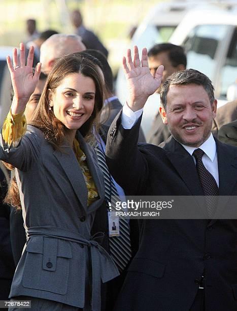 King of the Hashemite Kingdom of Jordan Abdullah II Bin AlHussein and Queen Rania Al Abdullah wave to media representatives after disembarking from...