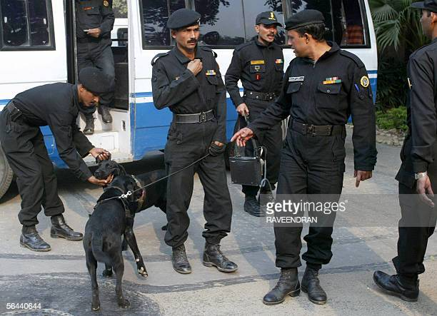 Members of the National Security Guard Bomb Disposal Squad arrive at Parliament House in New Delhi 16 December 2005 after a security alert India's...