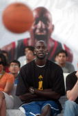 National Basketball Association basketball player and Adidas India Brand Ambassador Kevin Garnett watches young Indian children play basketball in...