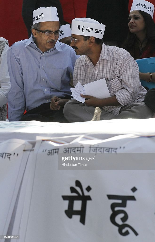 New Delhi, India - November26; Activist turned politician Arvind Kejriwal listens to fellow party member Prashant Bhushan (L) after the launch of the 'Aam Aadmi Party' on November 26, 2012 in New Delhi, India.