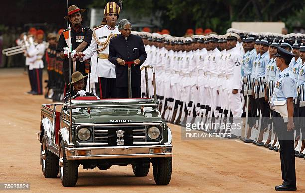 Outgoing Indian President A P Abdul Kalam inspects a guard of honour at the Presidential Palace in New Delhi 25 July 2007 India's first woman...