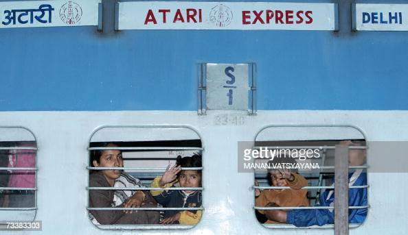 Passengers travelling by the Samjhauta Express wave goodbye to relatives at the Old Delhi Railway Station in Delhi 21 February 2007 The twiceweekly...