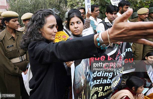 Renowned Indian writer and social activist Arundhati Roy gestures along with activists of the National Alliance of People's Movement and various...