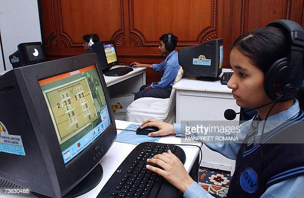 TO GO WITH AFP STORY by DEBORAH COLE FILES A picture taken 05 March 2006 shows an Indian girl using a computer in a temporary classroom set up during...