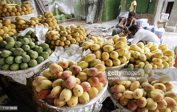 TO GO WITH 'INDIATRADEEXPORTSMANGO' Mangoes are displayed on sale at a roadside shop in New Delhi 20 May 2006 as Indian fruit sellers wait for...