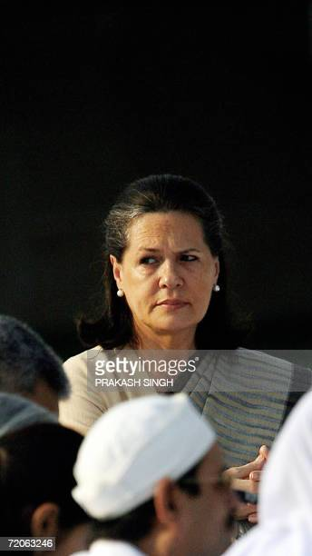 United Progressive Alliance government Chairperson and Congress Party President Sonia Gandhi listens to religious songs while paying tribute at...