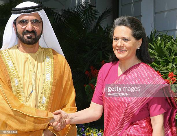 VicePresident and Prime Minister of United Arab Emirates and Ruler of Dubai Sheikh Mohammed bin Rashid Al Maktoum shakes hands with Chairperson of...
