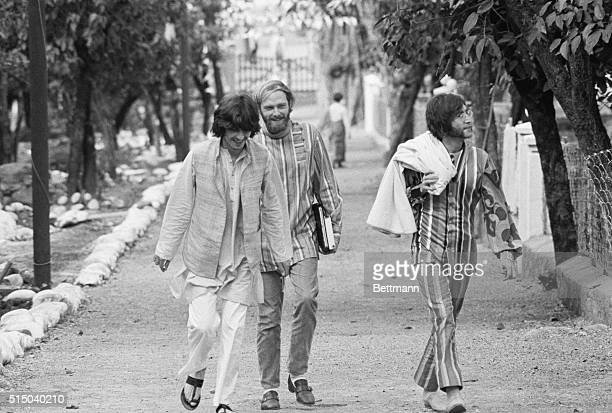 The Beatles In India Beatles George Harrison and John Lennon sporting Indian attire and joined by Mike Love of the Beach Boys stroll happily through...