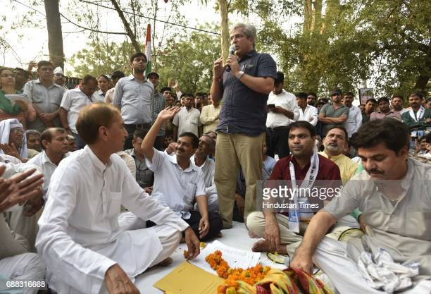 New Delhi Transport Minister Kailash Gahlot speaks as Delhi CM Arvind Kejriwal welcomed by the villagers of Chawala during a panchayat meeting in the...