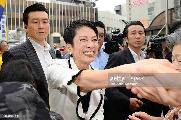 New Democratic Party President Renho shakes hands with supporters as she makes a street speech for her party candidate of the Fukuoka No 6...
