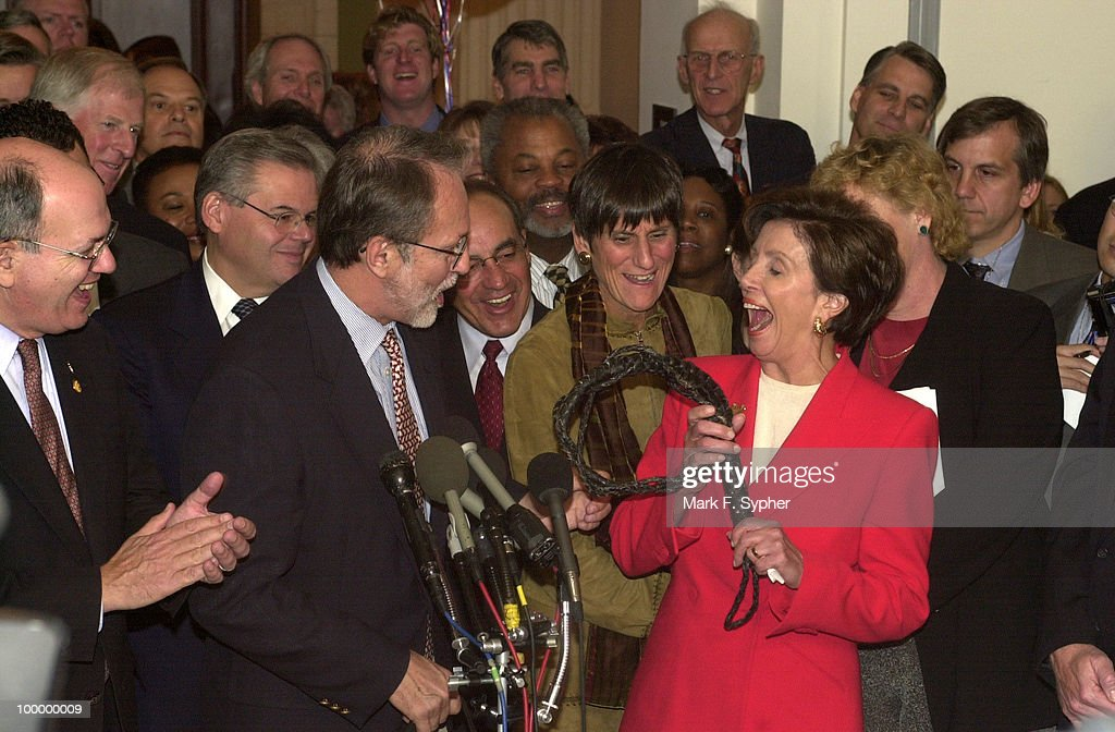 New Democratic Whip, Nancy Pelosi (D-CA) steps out of the Cannon Caucus room and is greeted by a new whip herself, courtesy of David E. Bonior (D-MI).