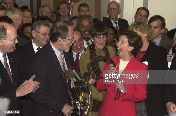 New Democratic Whip Nancy Pelosi steps out of the Cannon Caucus room and is greeted by a new whip herself courtesy of David E Bonior