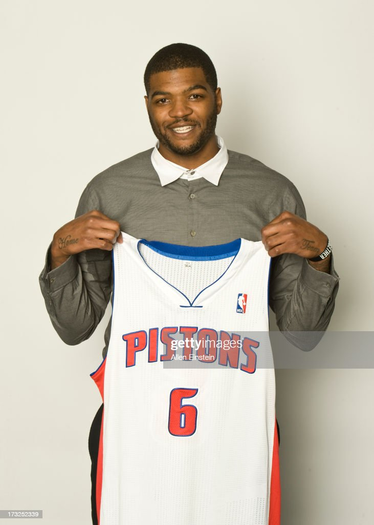 New Detroit Pistons player Josh Smith poses with his new jersey at a press conference on July 10, 2013 at Palace of Auburn Hills in Auburn Hills, Michigan.
