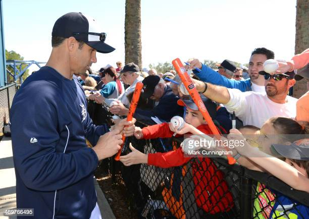 New Detroit Tigers manager Brad Ausmus signs autographs for fans during the spring training workout day at the TigerTown Complex on February 14 2014...