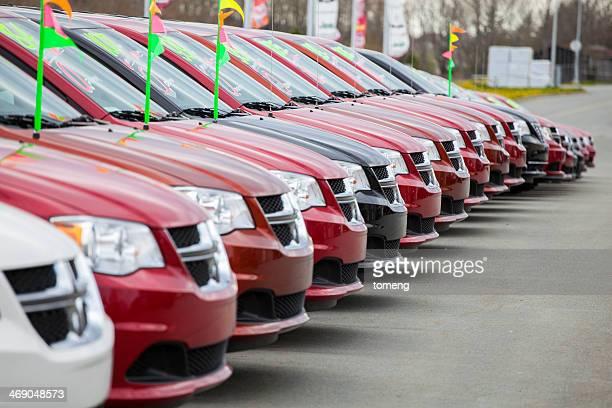 New Dodge Caravans in a Row at Car Dealership