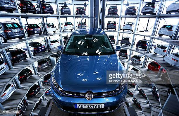 A new eGolf vehicle of German car maker Volkswagen is seen in one of the twin car towers at the Volkswagen factory during a visit on the sidelines of...