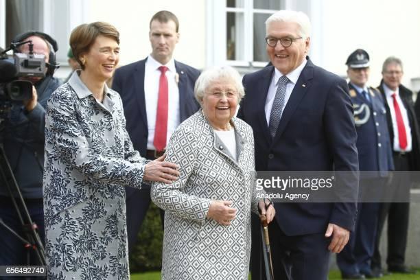 New elected German President FrankWalter Steinmeier and his wife Elke Buedenbender welcome president's mother Ursula Steinmeier during the Military...