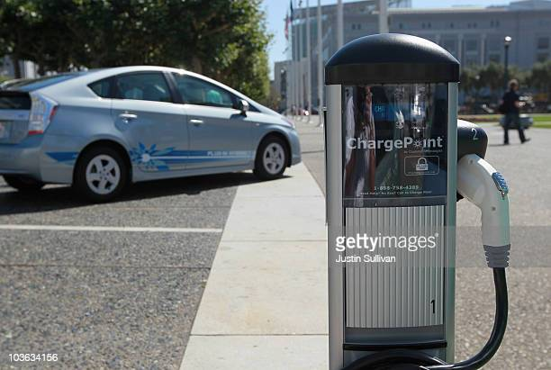 A new electric vehicle charging station is seen near San Francisco city hall August 25 2010 in San Francisco California With sales of electric and...
