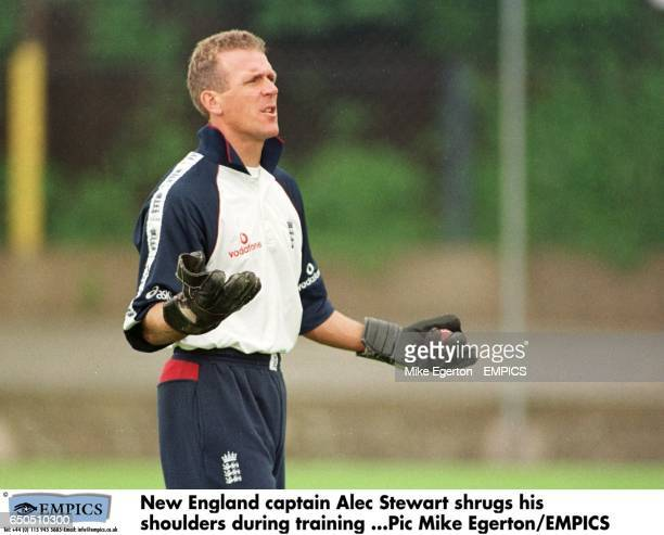 New England captain Alec Stewart shrugs his shoulders during training