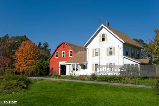 New England Farmhouse with red barn in autumn colors